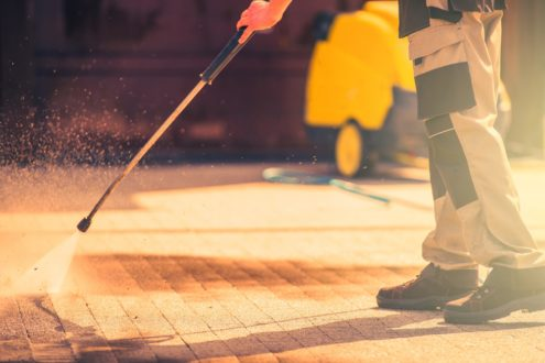 professional using pressure cleaning to clean domestic bricks - MKL Pressure cleaners